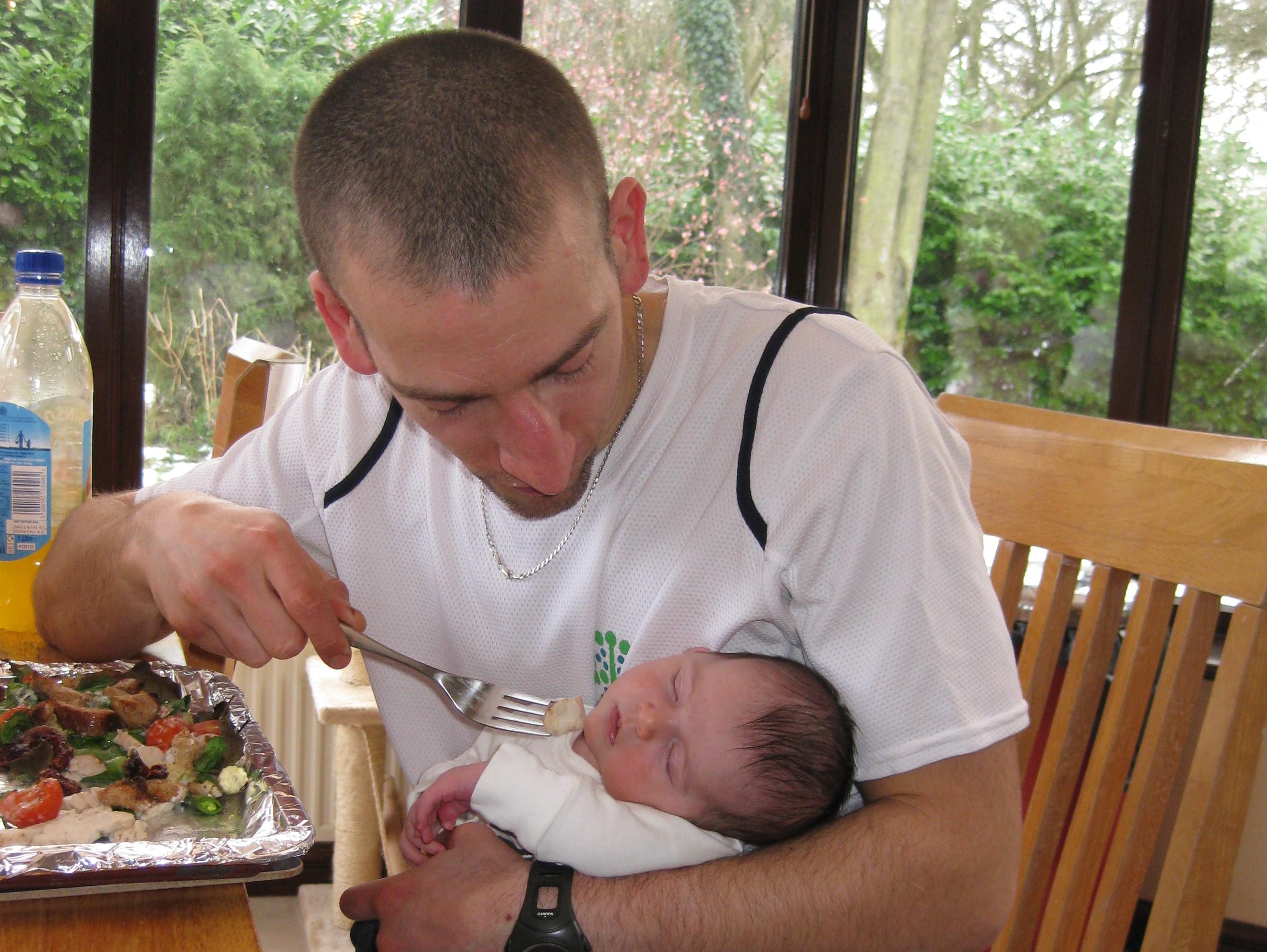 Steve feeding baby